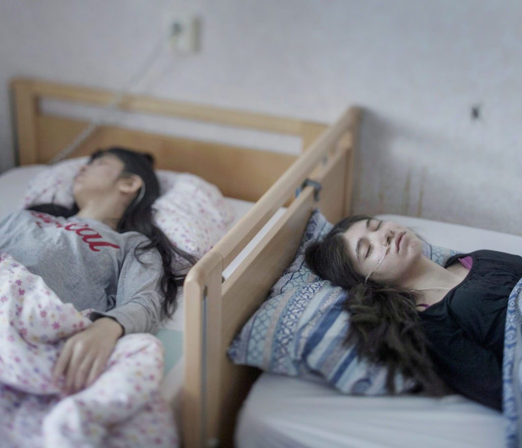 uppgivenhetssyndrom, or resignation syndrome, is said to exist only in sweden, and only among refugees. the patients seem to have lost the will to live. they are like snow white, a doctor said. they just fall away from the world. djeneta have been bedridden and unresponsive for two and a half years and her sister ibadeta for more than six months.